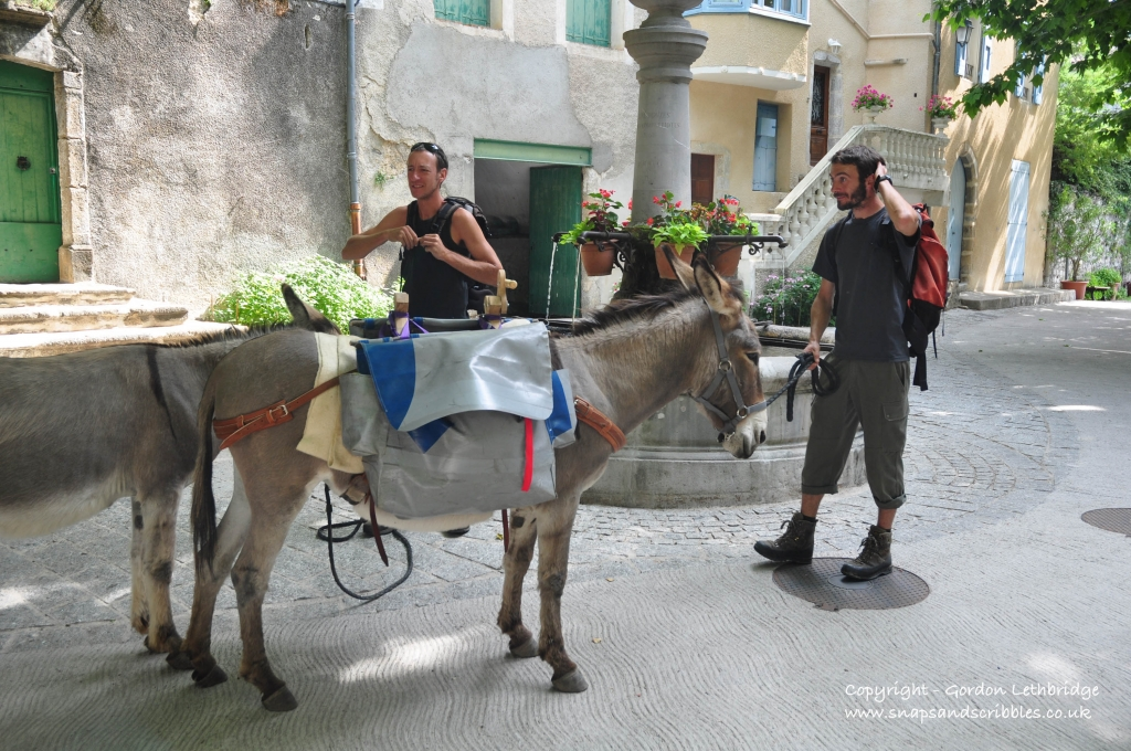 Walking with a donkey through one of the villages of the Cevennes