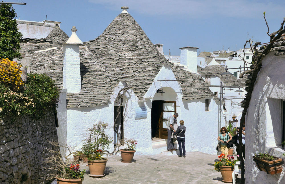 Lichen covered roofs and white-washed walls are typical of today's trulli but it was not always so...