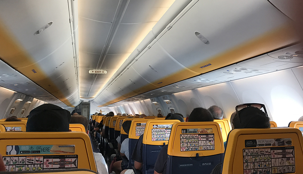 Blue and yellow interior of Ryanair aircraft